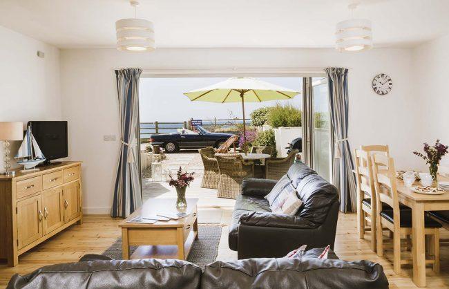 The Beach living area with patio doors open