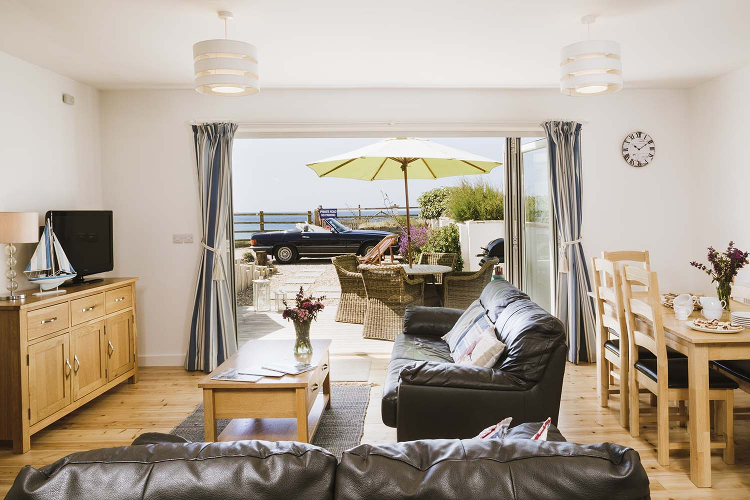The Beach living area with patio doors open