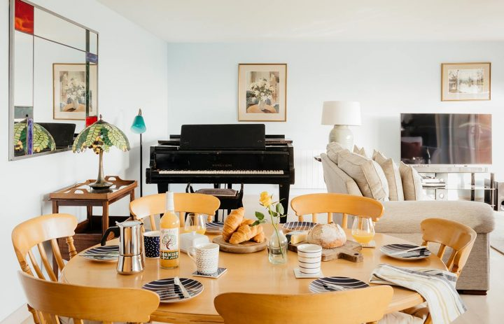 Bodeeve-Living-Room-with-Piano-&-Dining